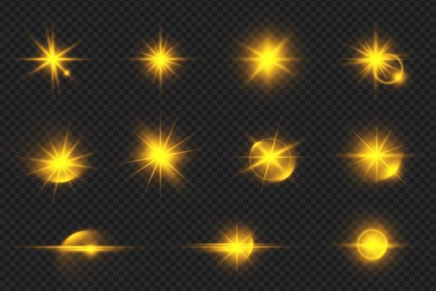 Conjunto de destellos de lente brillantes dorados realistas