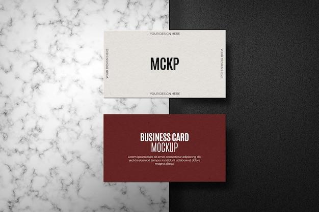 Conjunto de maquetas de tarjetas de visita en superficie de mármol