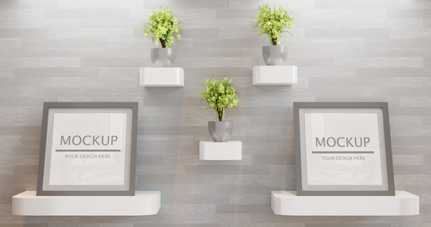 Coppia cornice quadrata mockup con decorazione di piante sul muro