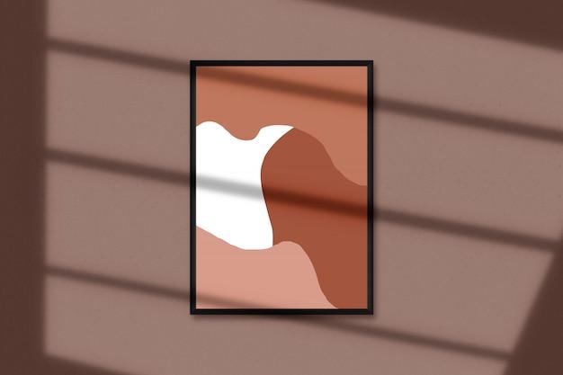 Cornice in bianco a4 per fotografie, arte, grafica con sovrapposizione di foglie d'ombra. modello isolato della cornice