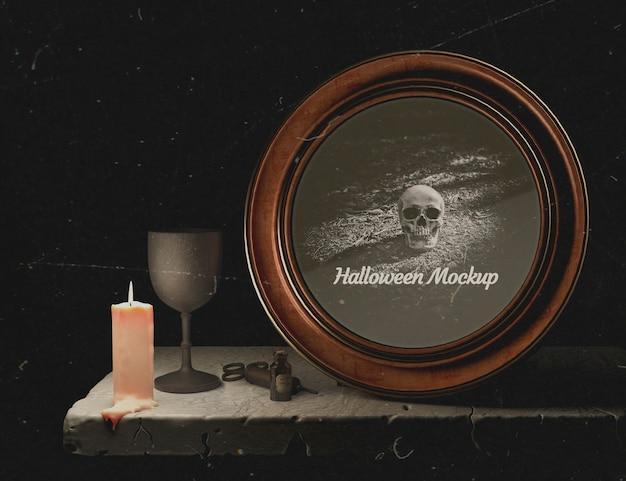 Cornice rotonda di halloween con teschio e candela