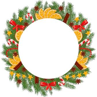 Corona di abete con agrumi, corona di abete decorata con agrumi e anice.