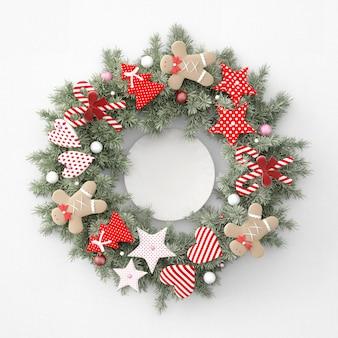 Corona navideña con comienzos, corazones y pan de jengibre