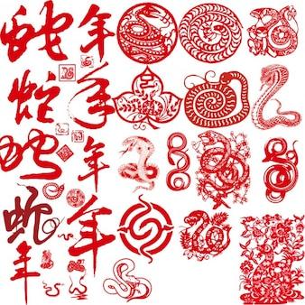 Corte de papel serpientes chinos rojos