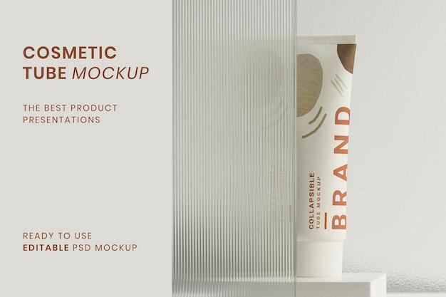 Cosmetische buismodel psd met productachtergrond met patroon van glastextuur