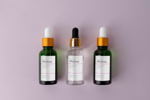 Cosmetische oliedruppelaars mock-up arrangement