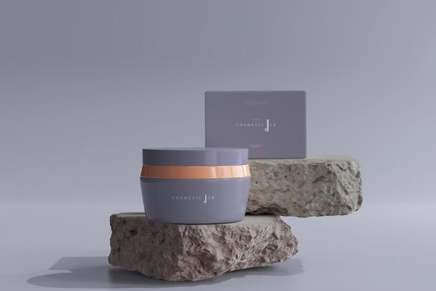 Cosmetische pot en doosmodel op rotsen