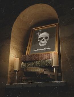 Cráneo en un marco con pila de libros y velas.