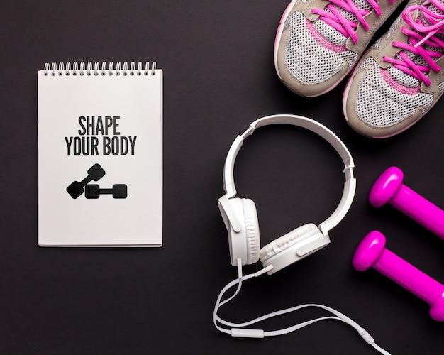 Cuaderno con mensaje motivacional de fitness