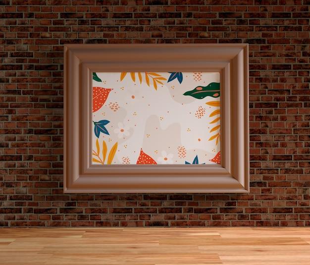 Cuadro minimalista colgado en la pared de ladrillo
