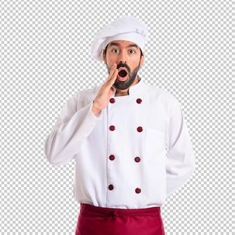 Cuoco unico che fa gesto di sorpresa sopra priorità bassa bianca