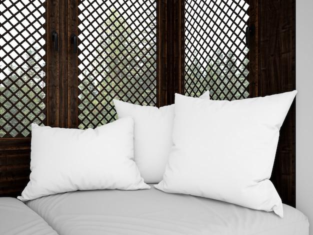 Cuscini bianchi realistici su un divano rustico