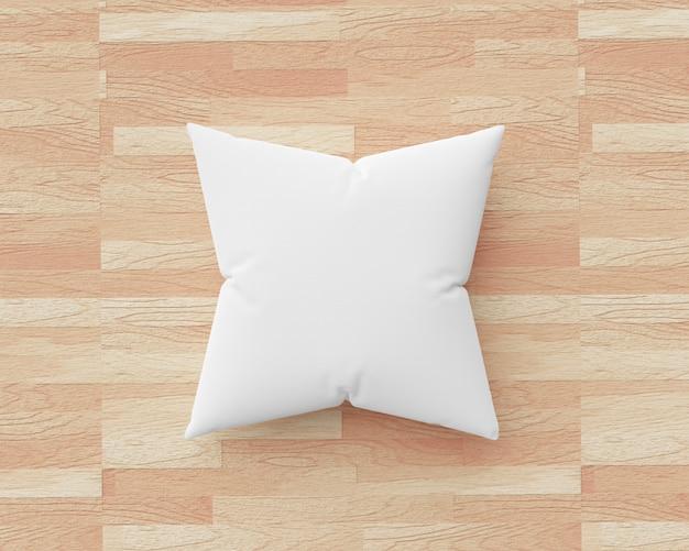 Cuscino bianco e forma quadrata sul fondo di legno del pavimento con il modello in bianco. mockup di cuscini per il design. rendering 3d.