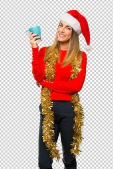 De blondevrouw kleedde zich omhoog voor kerstmisvakantie