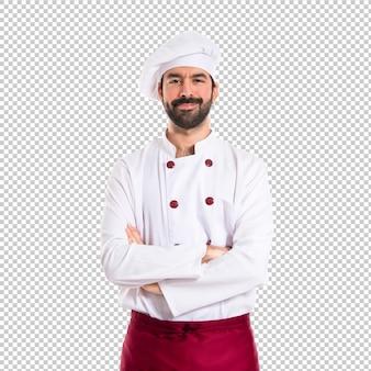 De chef-kok met zijn wapens kruiste over witte achtergrond