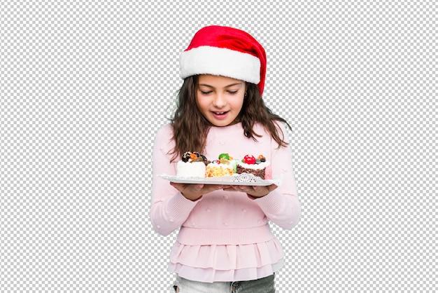 De holdingssnoepjes die van het meisje kerstmisdag vieren