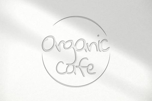 Deboss logo mockup psd voor biologisch café