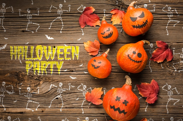 Decoración de calabazas de halloween y dibujo de esqueleto