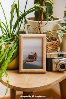 Decoración de mockup de marco con cámara