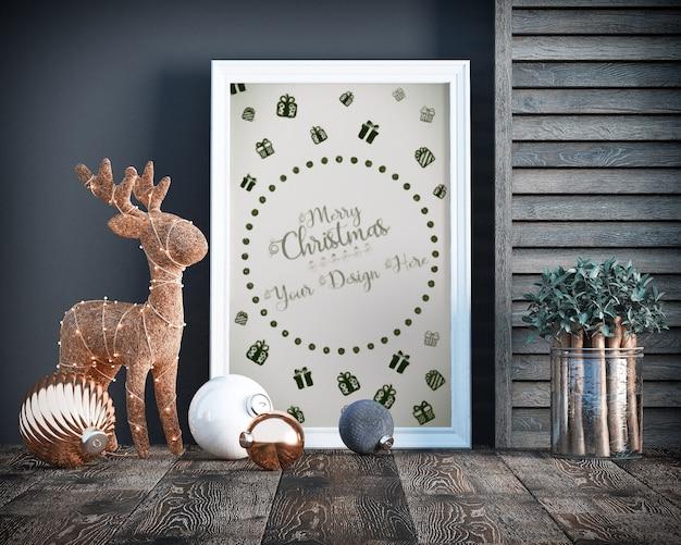 Decoración navideña con maqueta de marco, árbol de navidad y cajas de regalo.