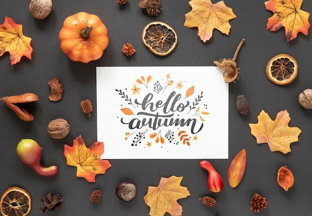 Decoración seca de otoño sobre fondo negro con maqueta