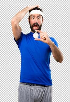 Desportista engraçada segurando o cronômetro vintage