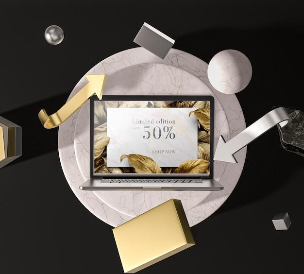 Digitale tablet met gouden bladeren bovenaanzicht