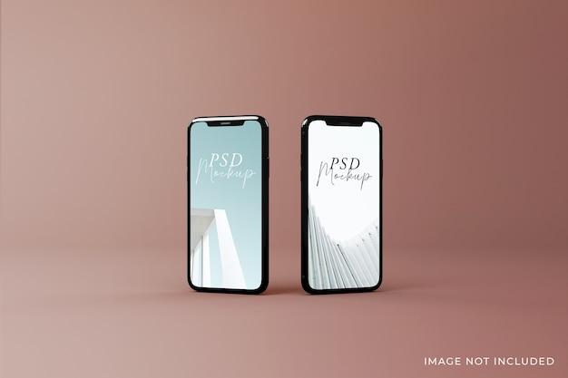 Diseño intercambiable de dos maquetas de pantalla móvil de alta calidad en la vista superior