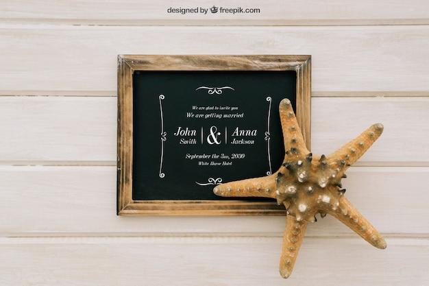 Diseño de mock up para bodas con pizarra y estrella de mar