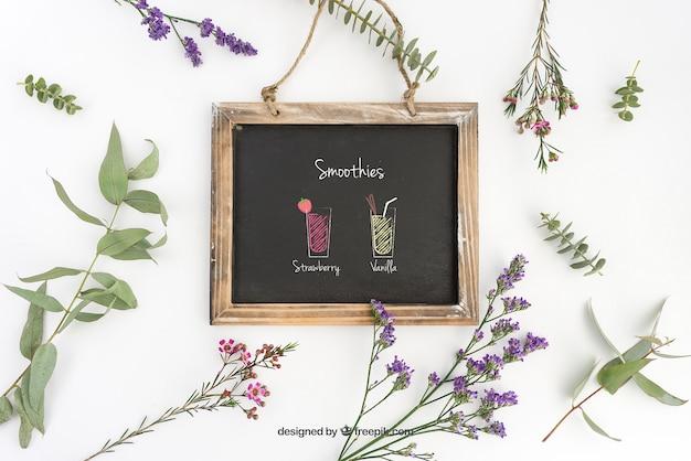 Diseño de mockup de pizarra con plantas decorativas