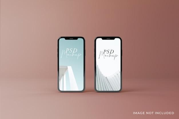 Diseño realista de dos maquetas de pantalla móvil de alta calidad en la vista superior