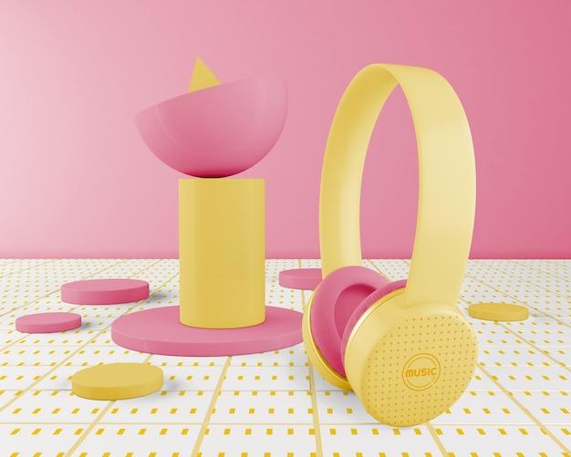 Disposición minimalista de auriculares amarillos
