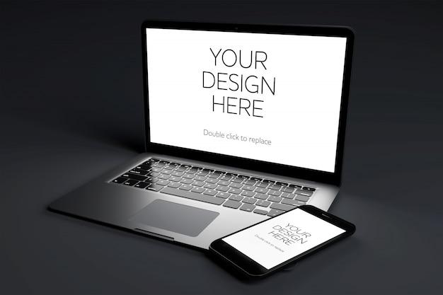 Dispositivo de computadora portátil con maqueta de pantalla en sala negra
