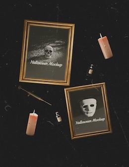 Disposizione di cornici di personaggi horror e lume di candela