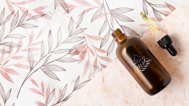 Disposizione piana della bottiglia e della pipetta dell'olio essenziale