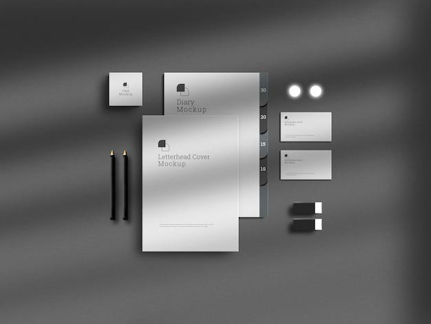 Donkere brandingset voor briefpapier met een papieren mockup en overdreven schaduw