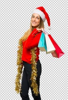 Donna bionda vestita per le vacanze di natale