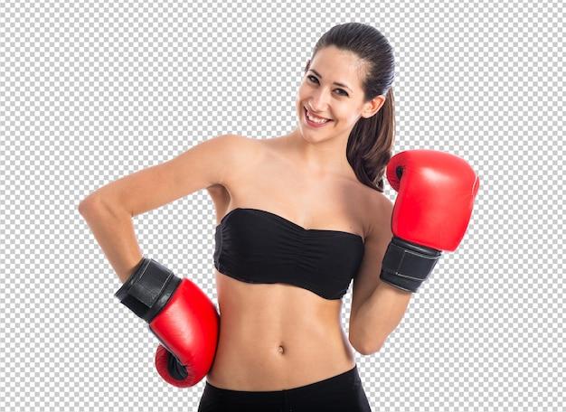 Donna sportiva felice con i guantoni da boxe