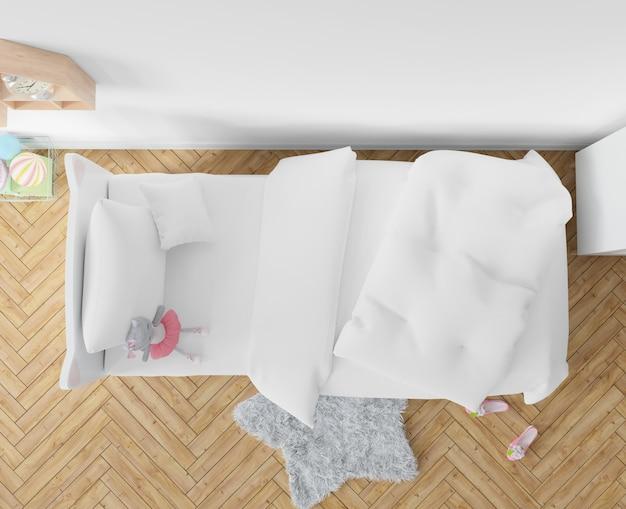 Dormitorio con sábanas blancas