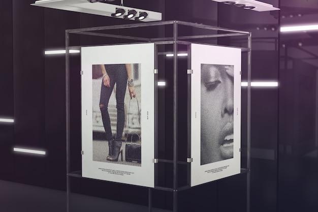 Dos carteles en maqueta de sala de exposición oscura