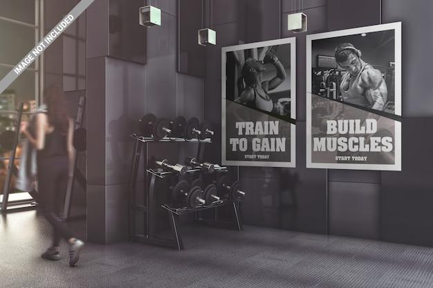 Dos pósteres en maqueta de gimnasio moderno.