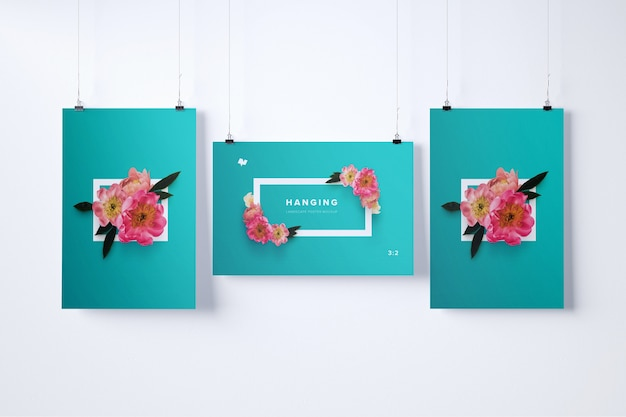 Drie hangende posters mockup