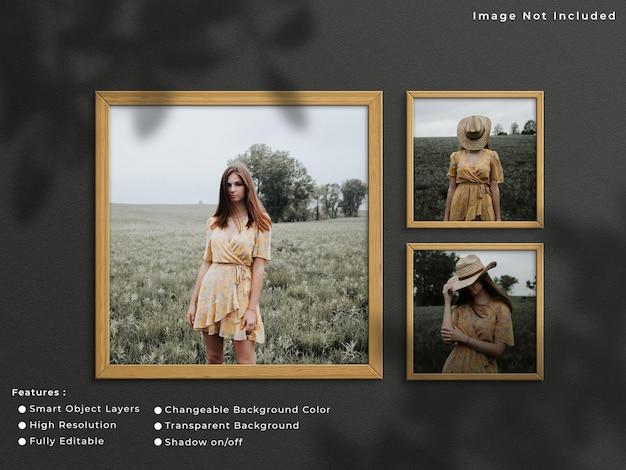 Drie vierkante houten fotolijst mockup opknoping op muur achtergrond met schaduw.