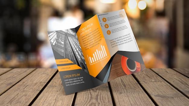 Driebladige brochure mockup op tafelblad