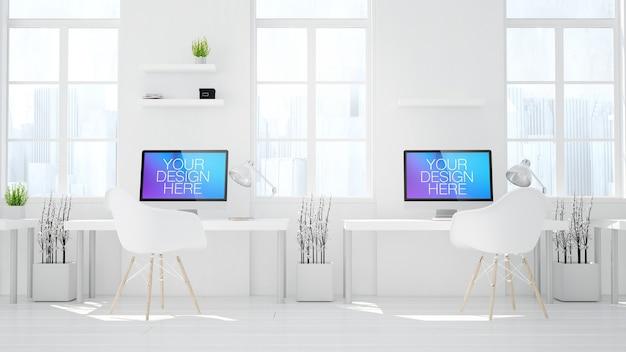 Due modelli di computer in un ufficio minimo
