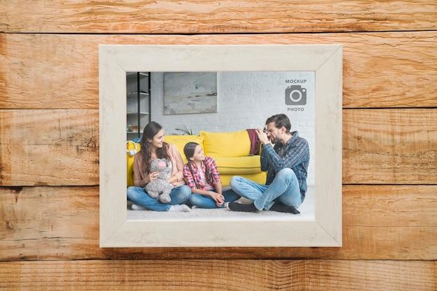 Eenvoudig rechthoekig frame op houten achtergrond