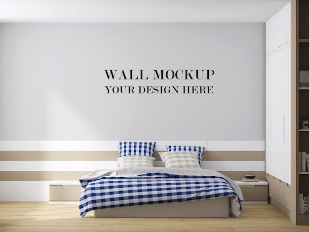 Eenvoudig slaapkamermuurmodel met geruite deken in de kamer
