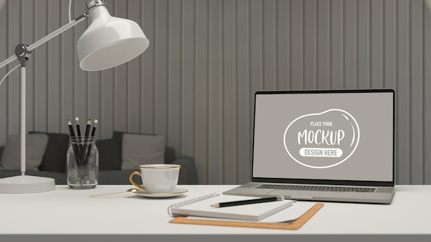 Eenvoudige werkruimte in de woonkamer met laptop briefpapier lamp en koffiekopje 3d-rendering