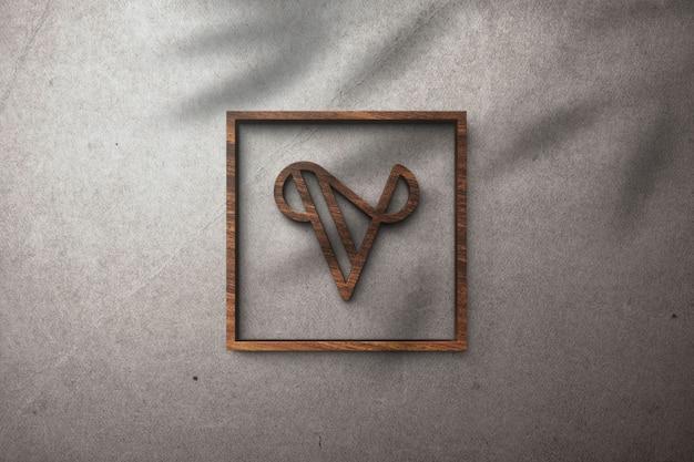 Efecto de madera de maqueta de logotipo 3d en una pared blanca