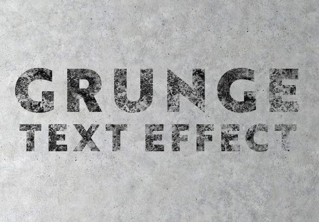 Efecto de texto de grunge sobre maqueta de textura concreta